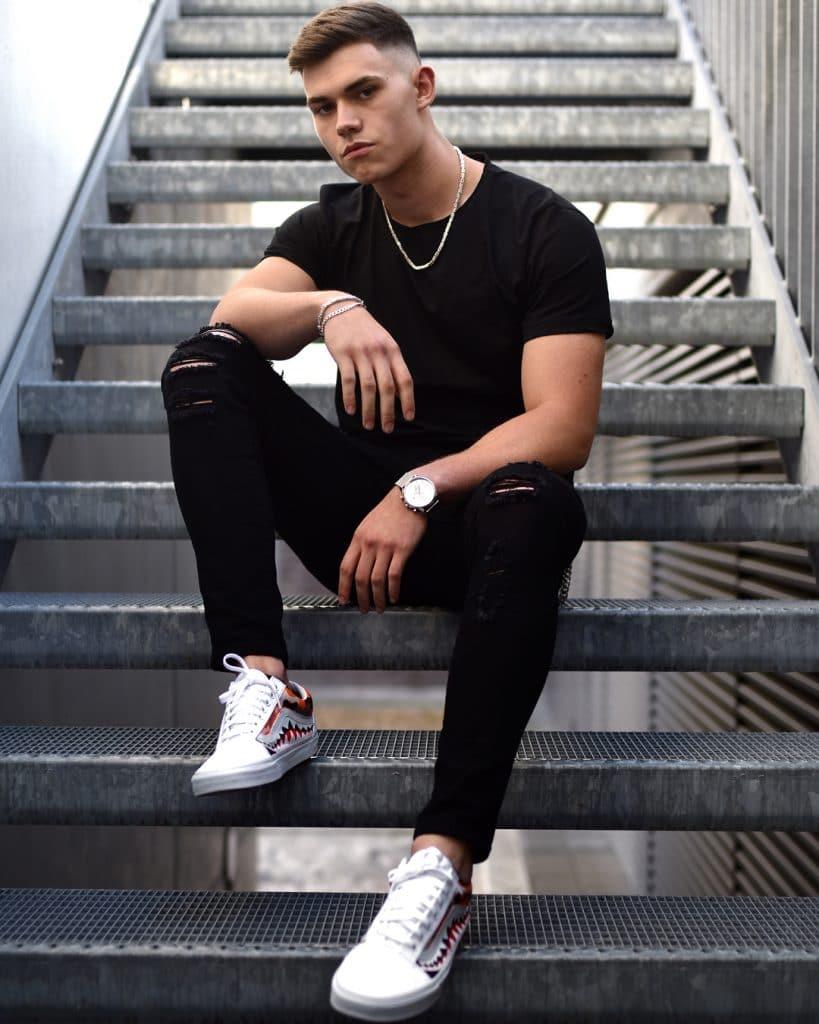 Black tee, black jeans, boots