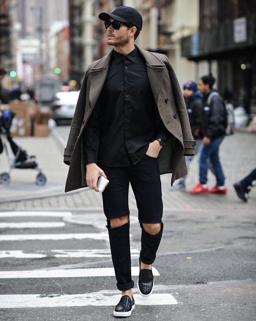 Black shirt, peacoat, black jeans, slip-on shoes