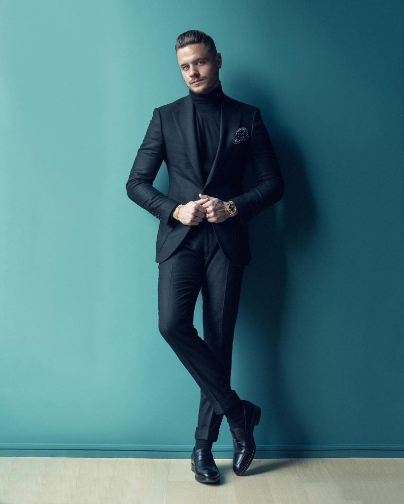 Black sweater, suit, leather shoes