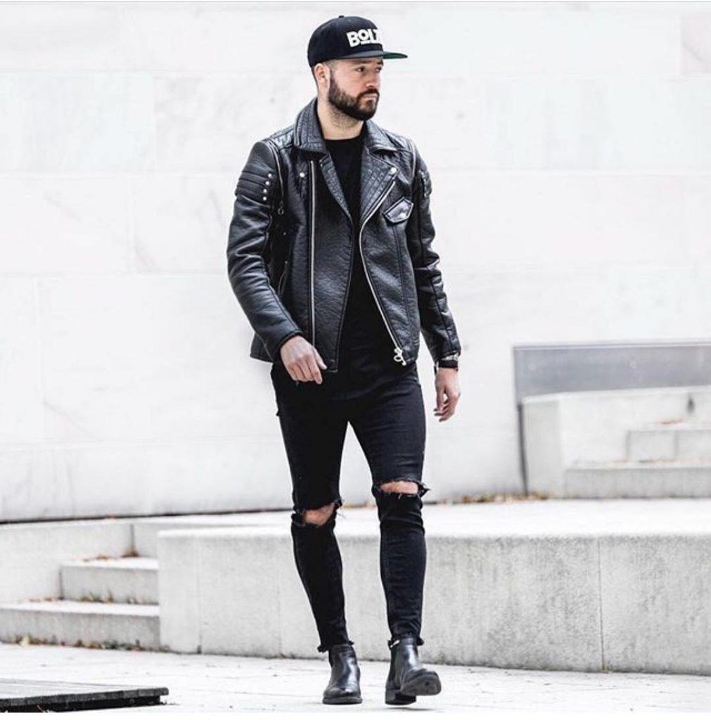 Leather biker jacket, tee, jeans, boots, snapback hat