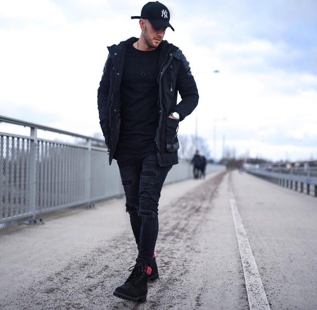 Black parka jacket, tee, jeans, sneaker, baseball cap