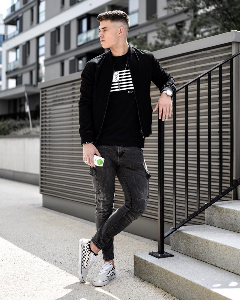 Black bomber jacket, tee, jeans, sneaker