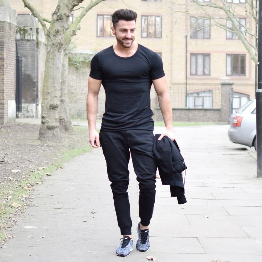 Black tee, sport pants, training shoes