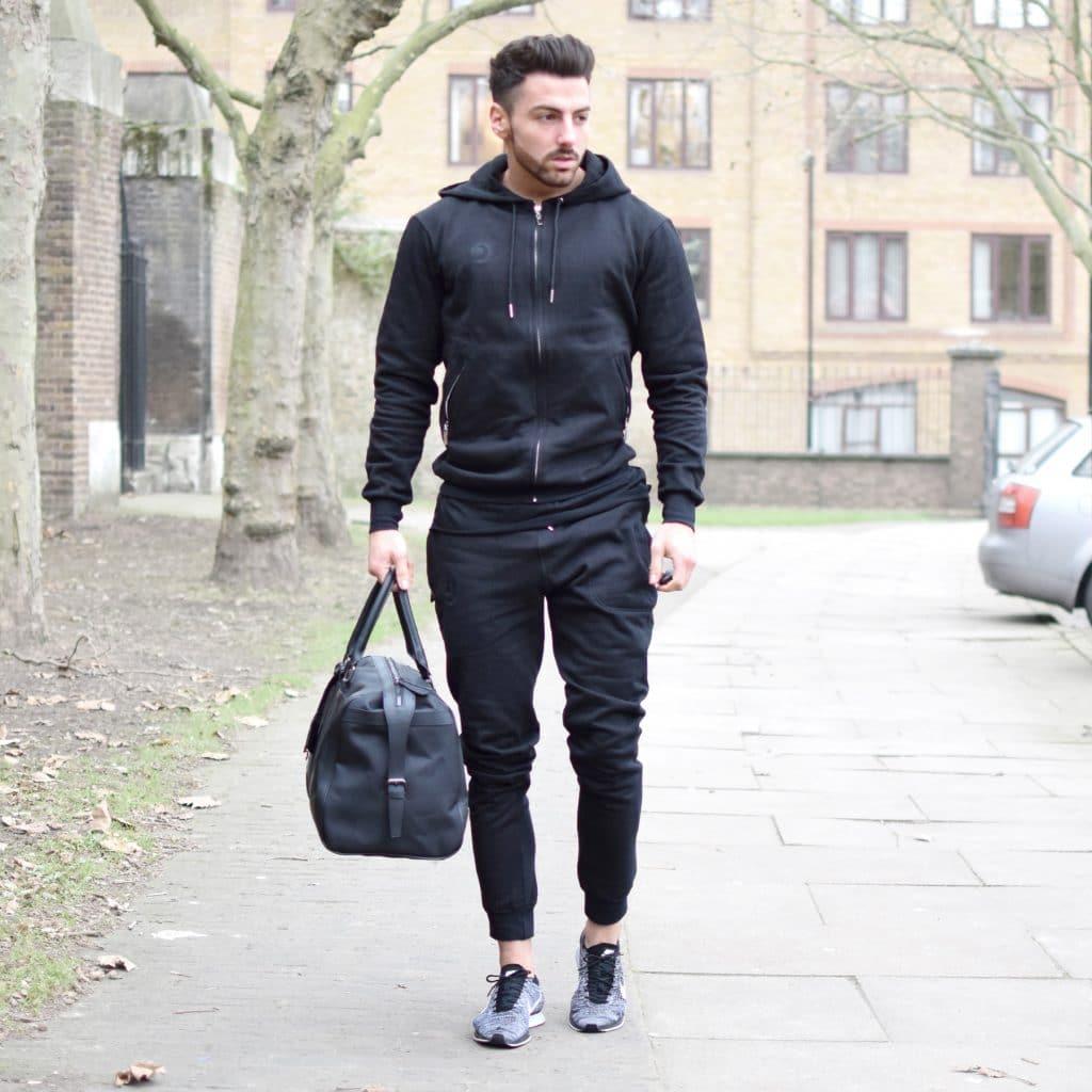 Black sport jacket, sport pants, training shoes