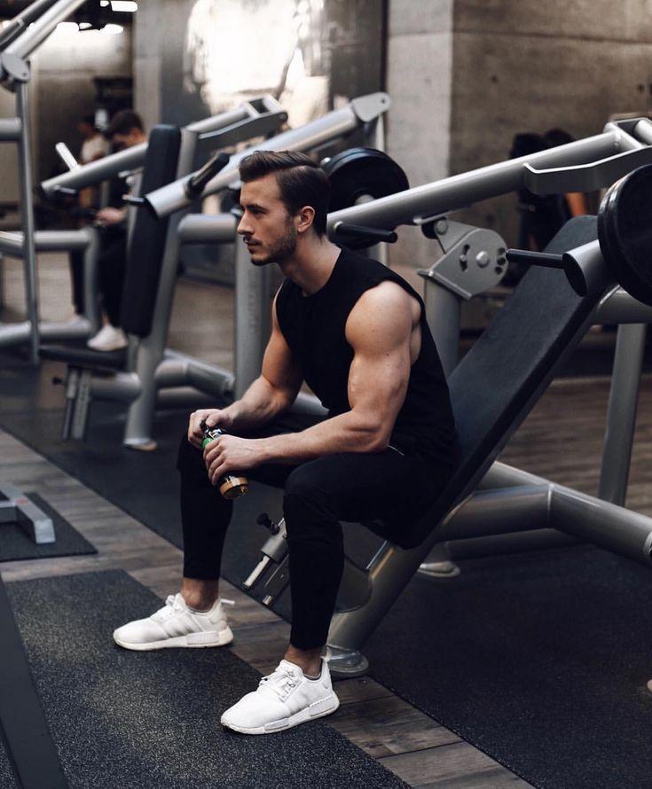 Black tank top, sport pants, training shoes