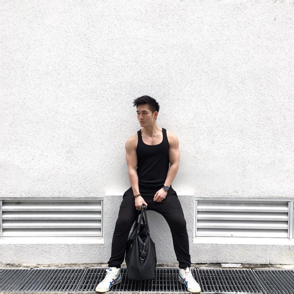 Black singlet, sport pants, training shoes