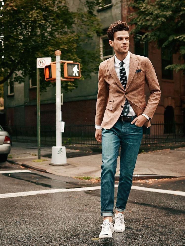 Brown wool blazer, blue jeans, white shirt, dotted tie and white sneaker