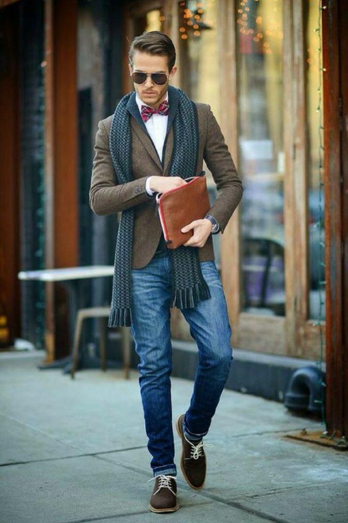 Dark brown wool blazer, white shirt, bow tie, scarf, blue jeans, and brown sneaker
