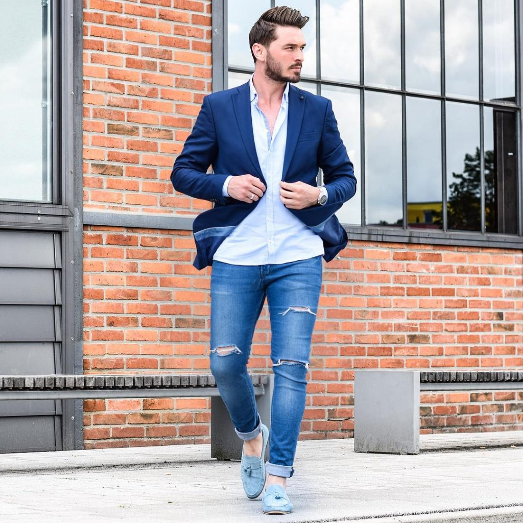 Blue blazer, light blue button-down shirt, ripped blue jeans, and loafers