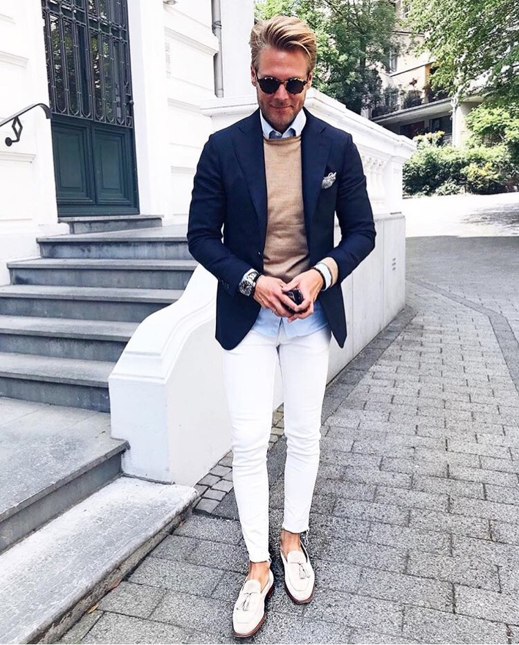 Blue blazer, light blue button-down shirt, brown sweater, white dress pants, and loafers