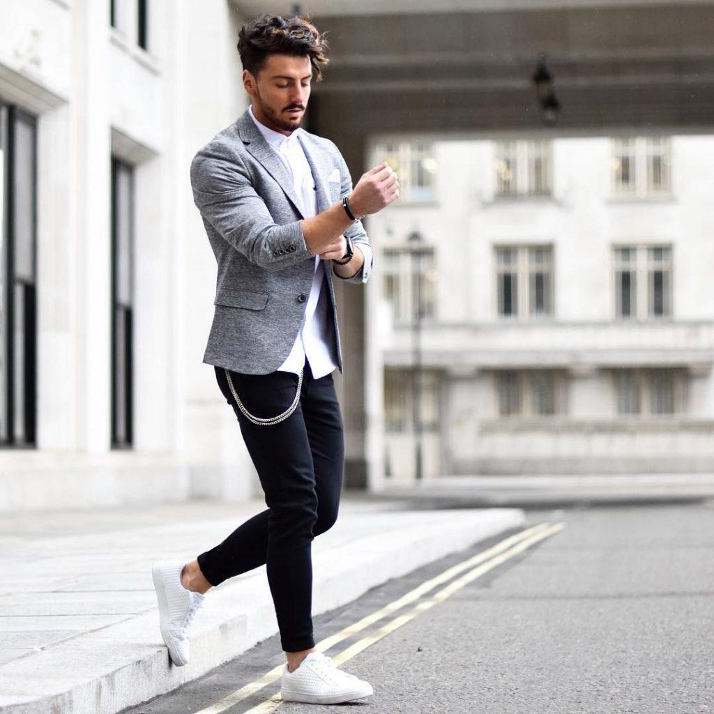 Gray wool blazer, white button-up shirt, dark dress pants, and white sneaker
