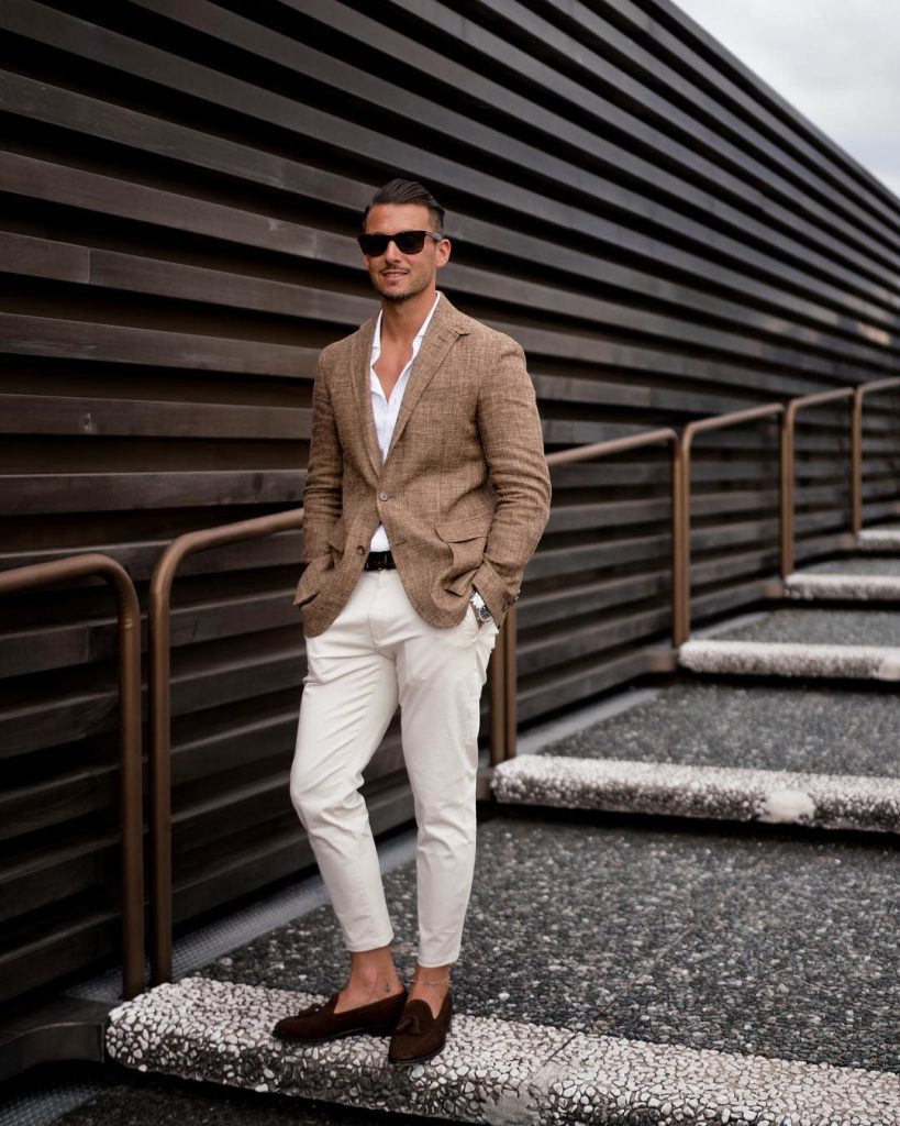Brown checked shirt, white button-down shirt, beige khaki pants, suede loafers