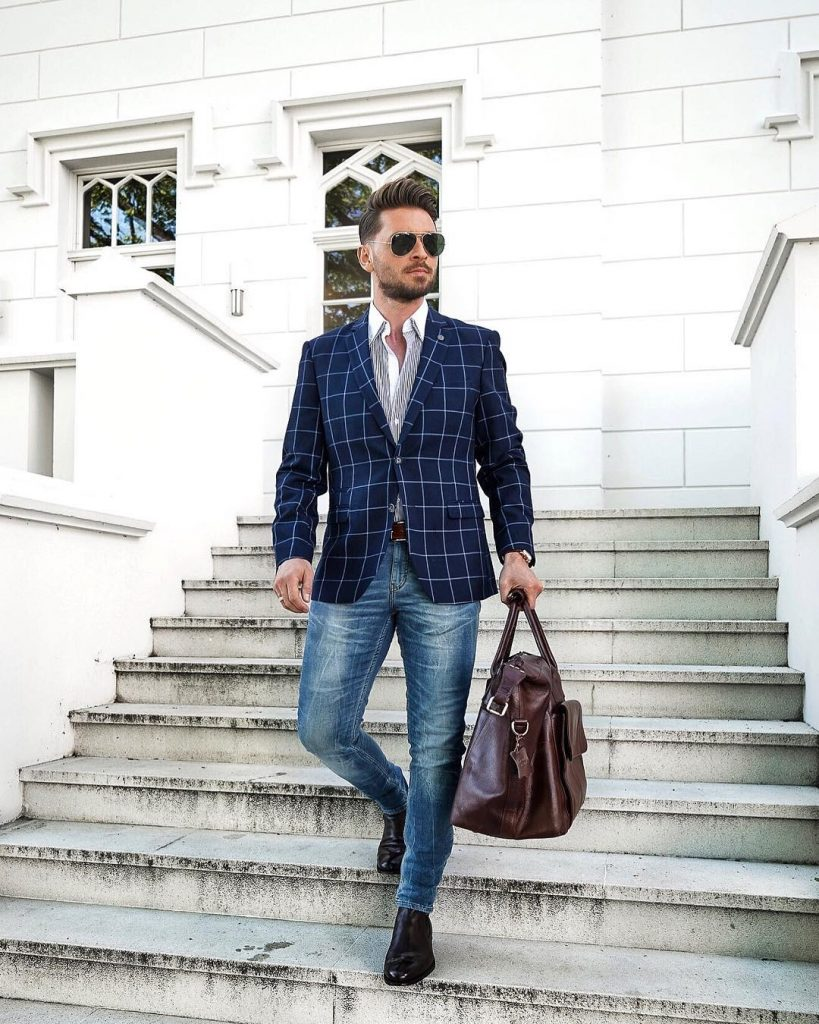 Blue checked blazer, white button-down shirt, blue jeans, and leather boots