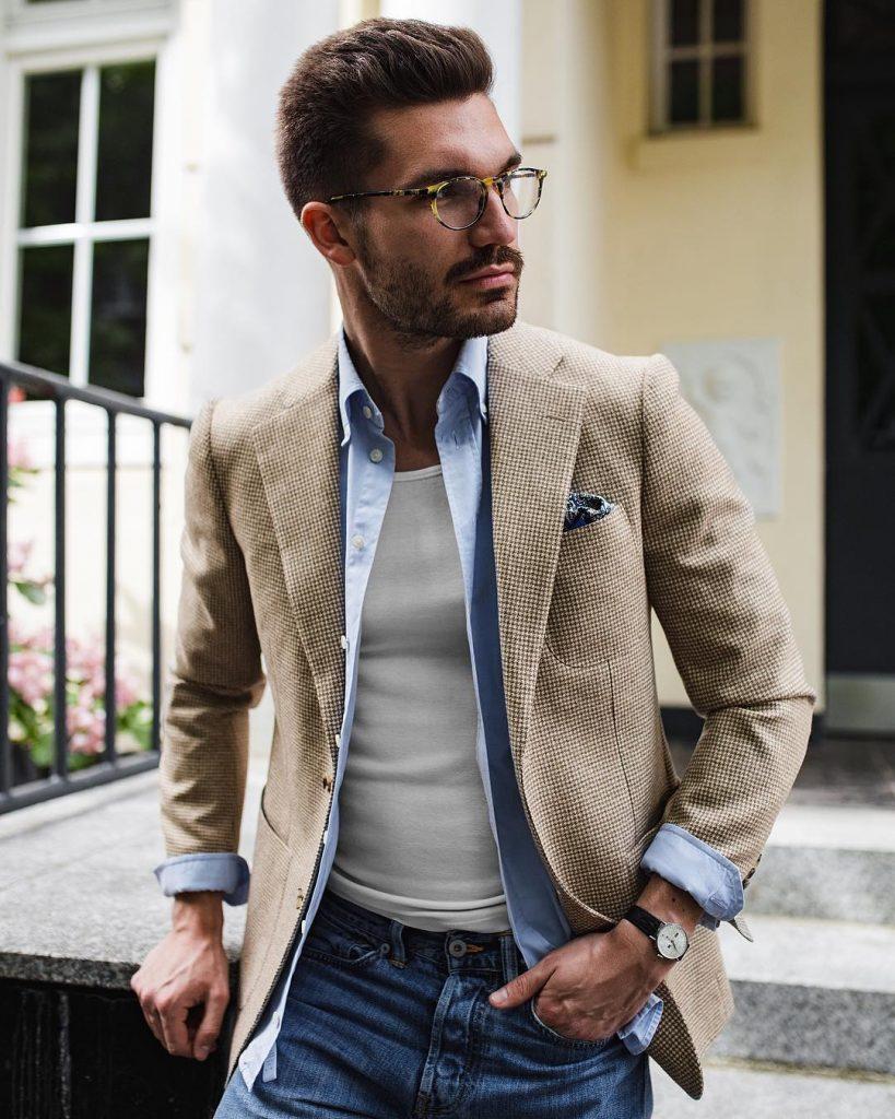 Tan checked blazer, light blue shirt, singlet, and blue jeans