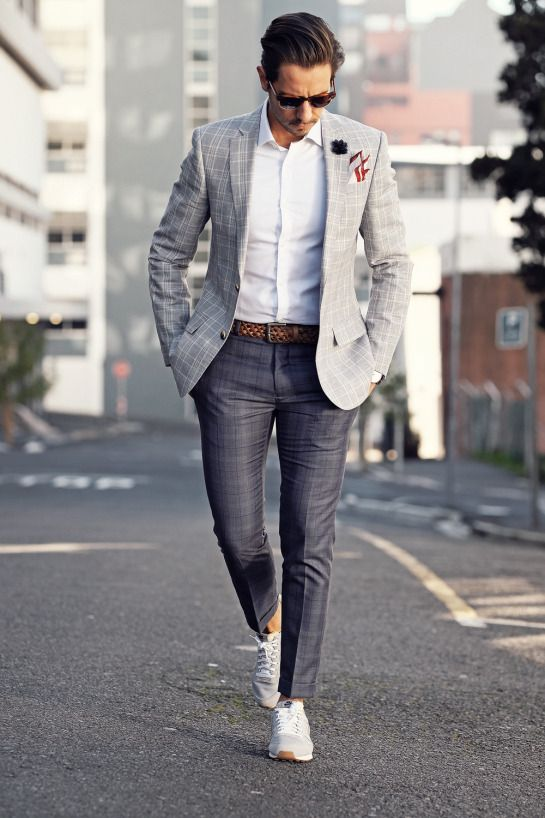 Gray checked blazer, white shirt, braided leather belt, checked dress pants, and training shoes