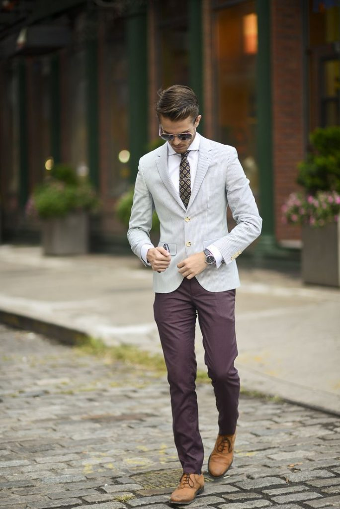 Gray pinstripe blazer, white shirt, printed tie, purple dress pants, and leather shoes
