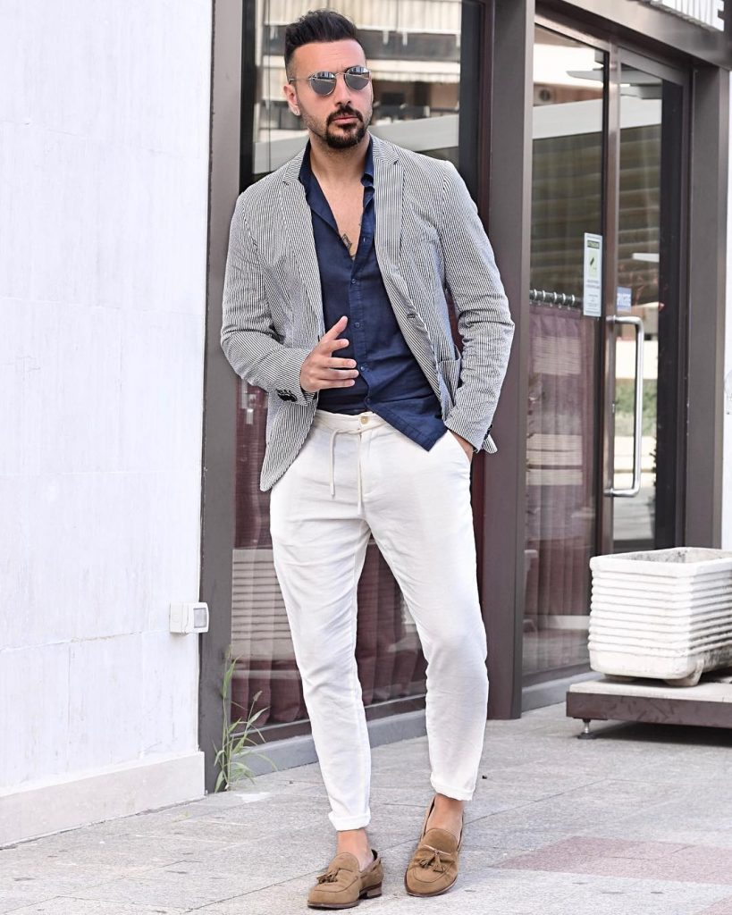 Pinstripe blazer, blue shirt, white pants, and brown loafers