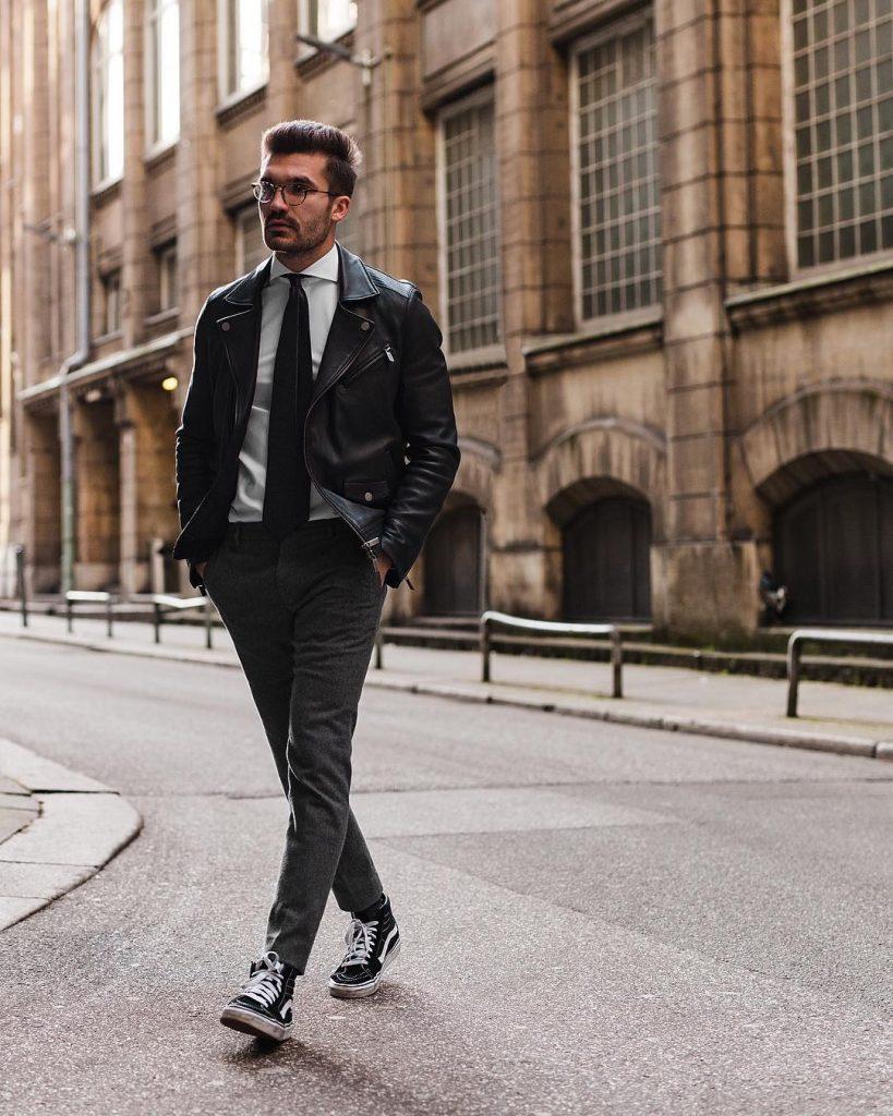 Leather biker jacket, white shirt, black tie, wool dress pants, and sneaker