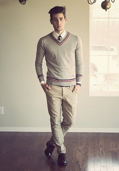White shirt, tie, sweater, tan khaki pants, and leather shoes