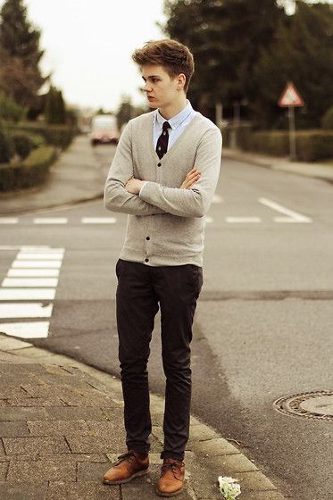 White shirt, tie, cardigan, dark brown trousers, and brown leather shoes