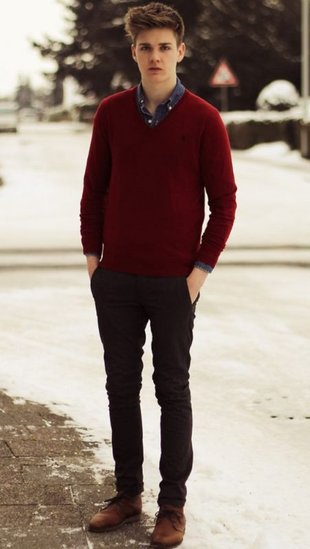 Denim shirt, red sweater, dark brown trousers, and brown leather shoes