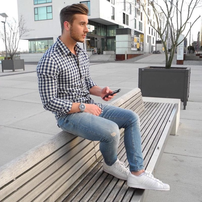 Checked shirt (smaller square), jeans, and white sneaker