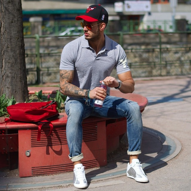 Gray polo shirt, blue jeans, cap, and white sneaker