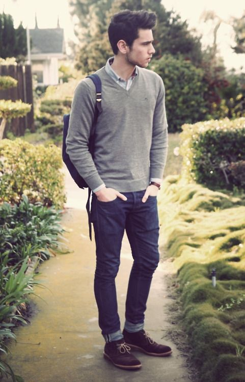 Gray shirt, sweater, jeans, and suede shoes