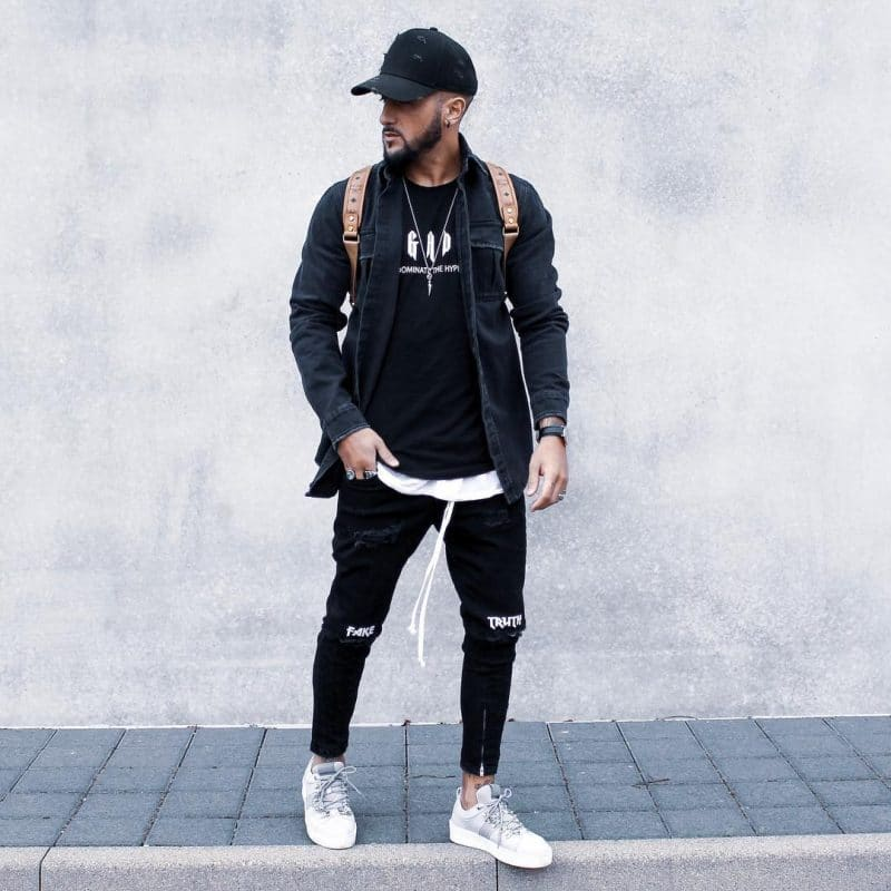 Black tee, black denim jacket, cap, black trousers,and sneaker
