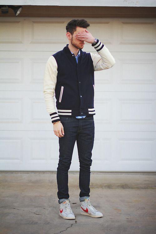 Light blue shirt, varsity jacket, dark blue jeans, and sneaker
