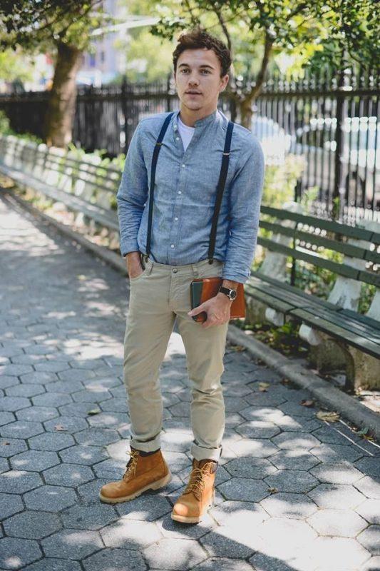 Mandarin collar blue overshirt, white tee, suspender, khaki pants, and boots
