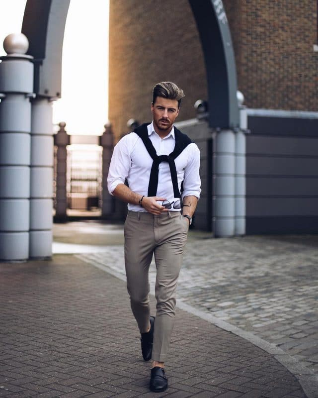 Tee shirt (wrap on the shoulder), white shirt, dark brown dress pants, and monk strap dress shoes