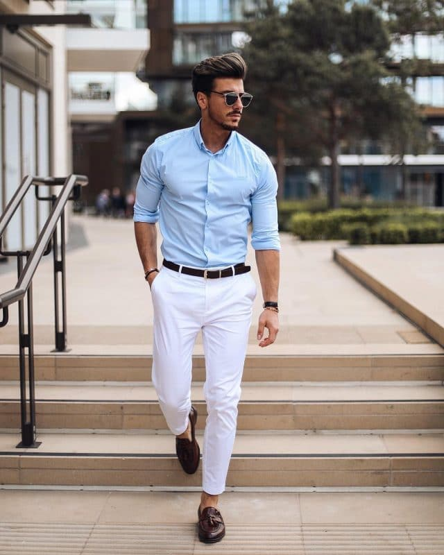 Light blue shirt, belt, white dress pants, and loafers