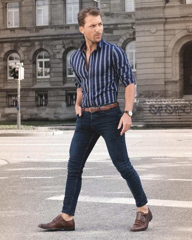 Blue pinstripe shirt, dark blue jeans and brown monk strap shoes