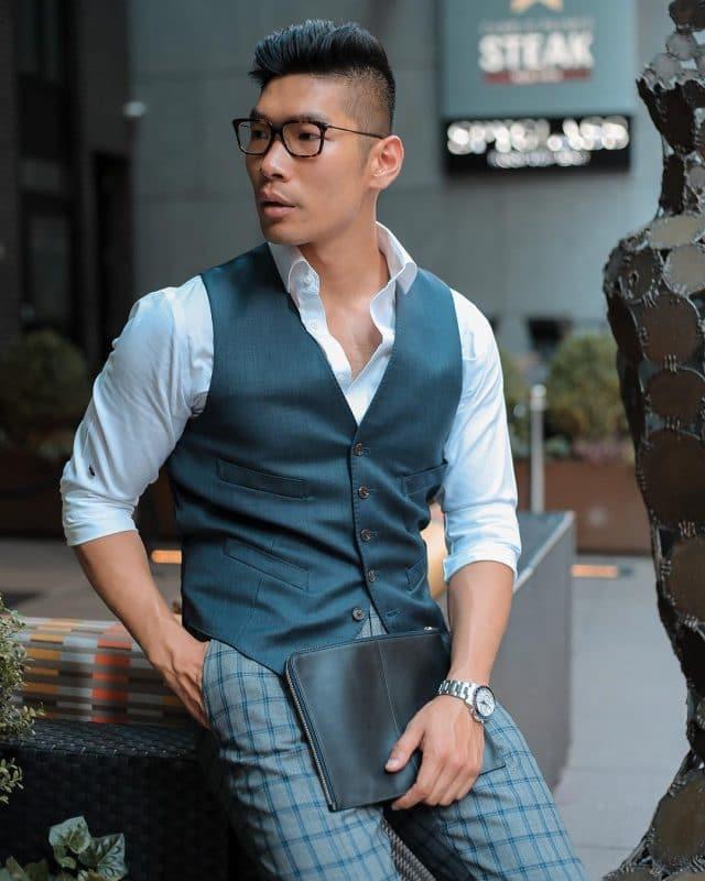 White shirt, dark blue vest and checked dress pants