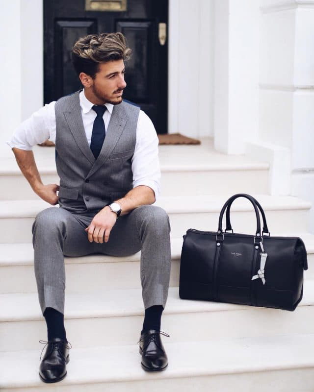White shirt, wool vest and pants, black tie, black socks and derby dress shoes