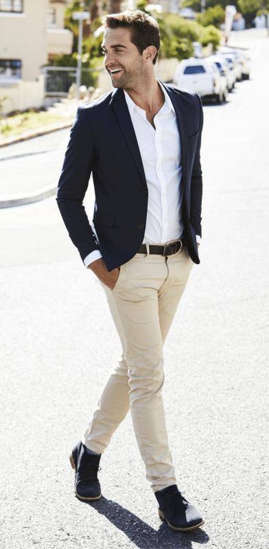 Black blazer, white shirt, chinos pants, and boots