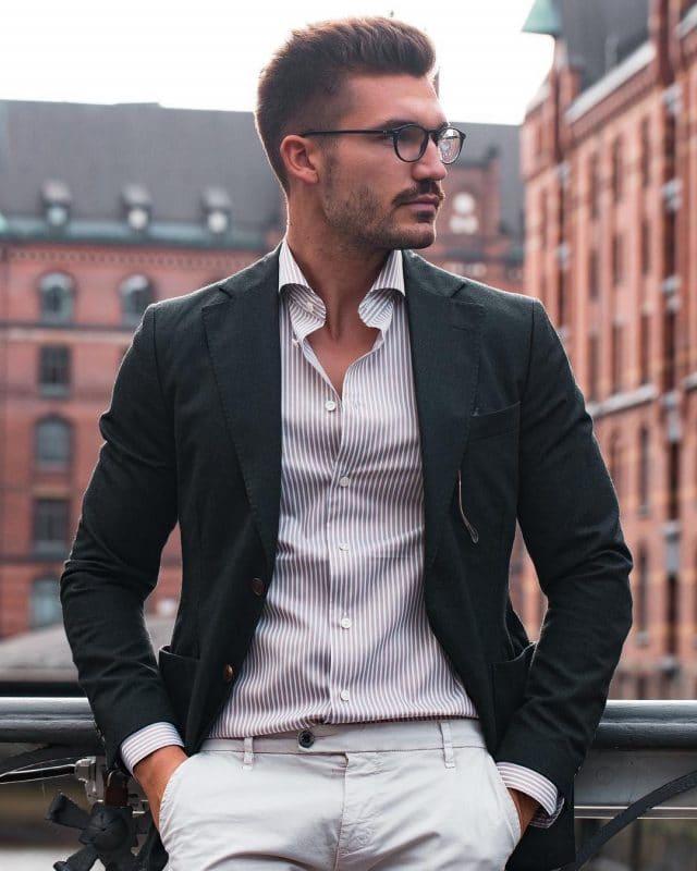 Dark color blazer, pinstripe shirt, and khaki pants