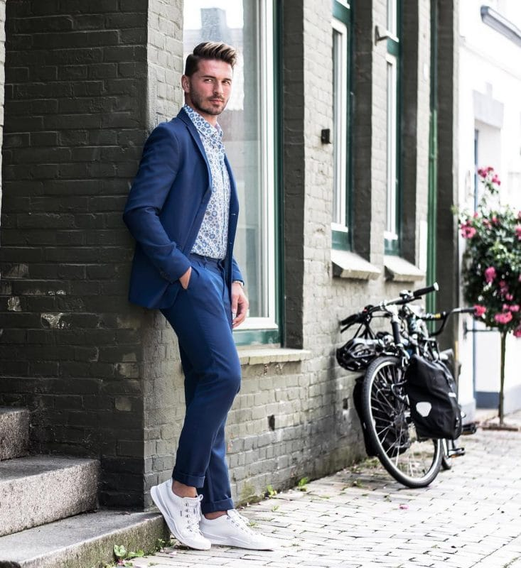 Printed shirt, blue suit, and white sneaker