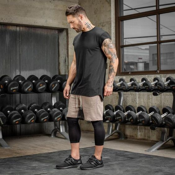 Black short sleeve tee, sport pants, 3/4 compression pants and sport shoes