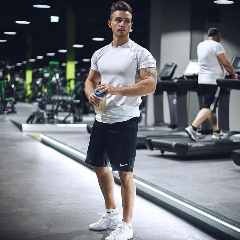 White dry-fit workout t-shirt, sport pants and sport shoes