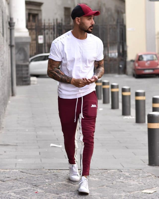 White tee, sweatpants, baseball cap and sneaker