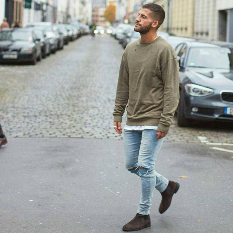 Olive green sweater over white tee, jeans 19