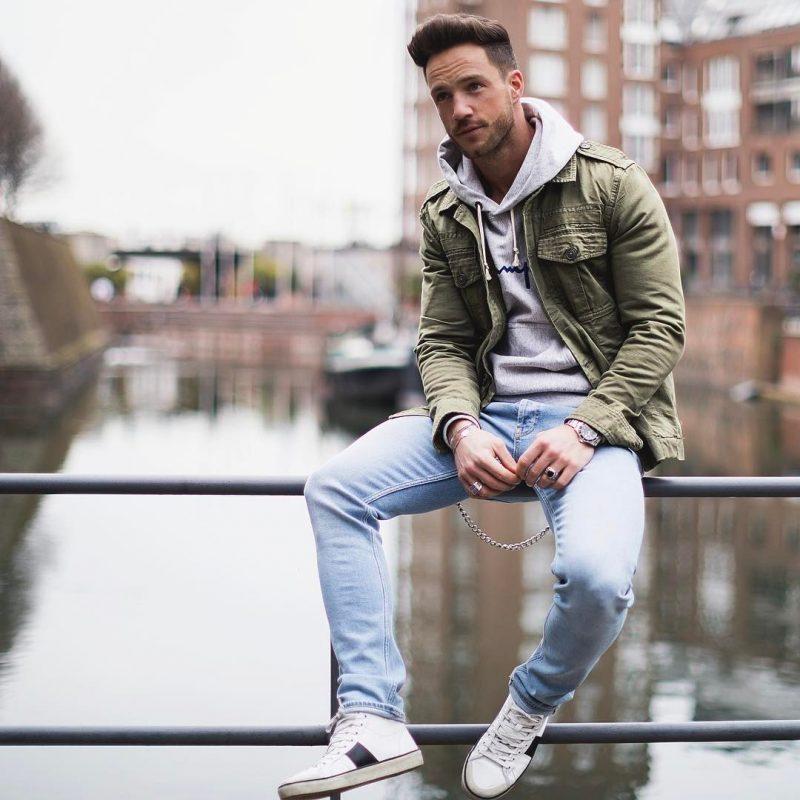 Army jacket over hoodie sweatshirt, jeans 24