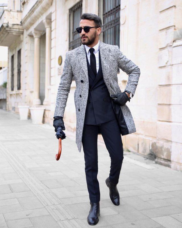 Wool overcoat over suit with tie 38