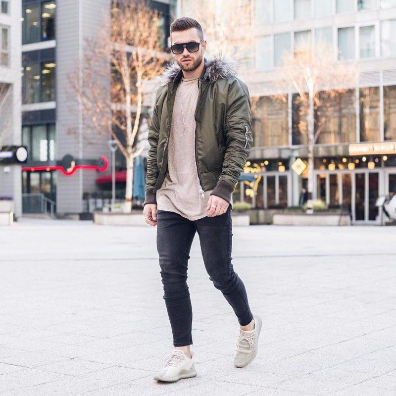 Bomber jacket, brown tee, jeans, sneaker