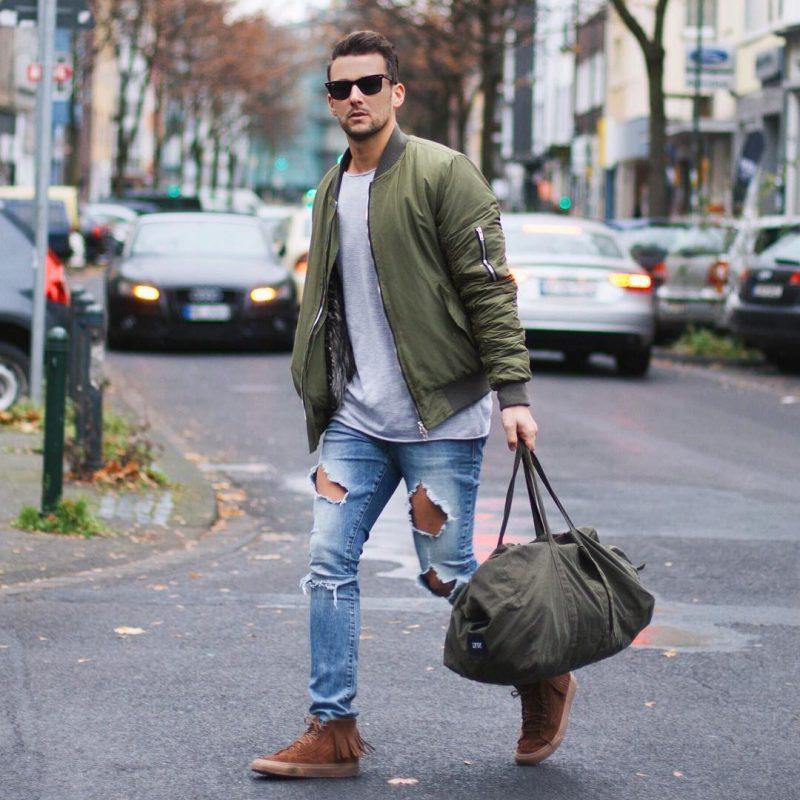 Bomber jacket, gray tee, jeans, sneaker