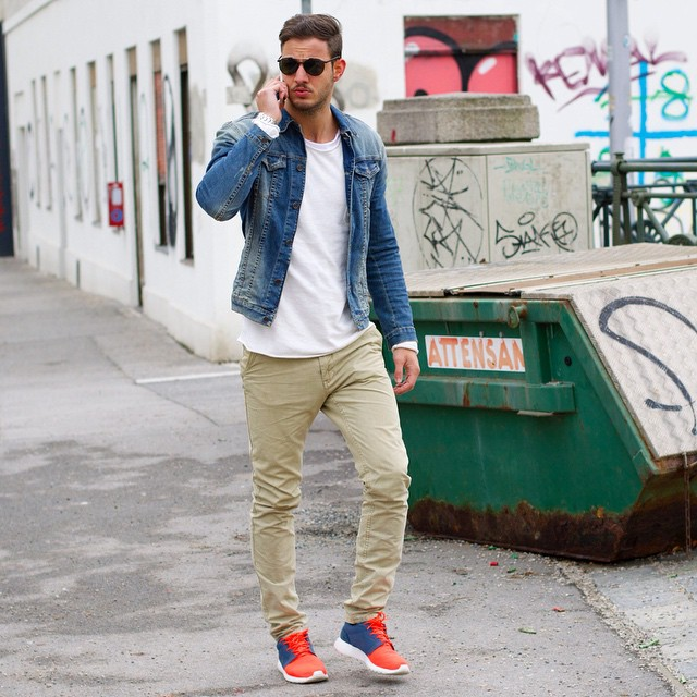 Blue denim jacket, white tee, beige chinos, sneaker.