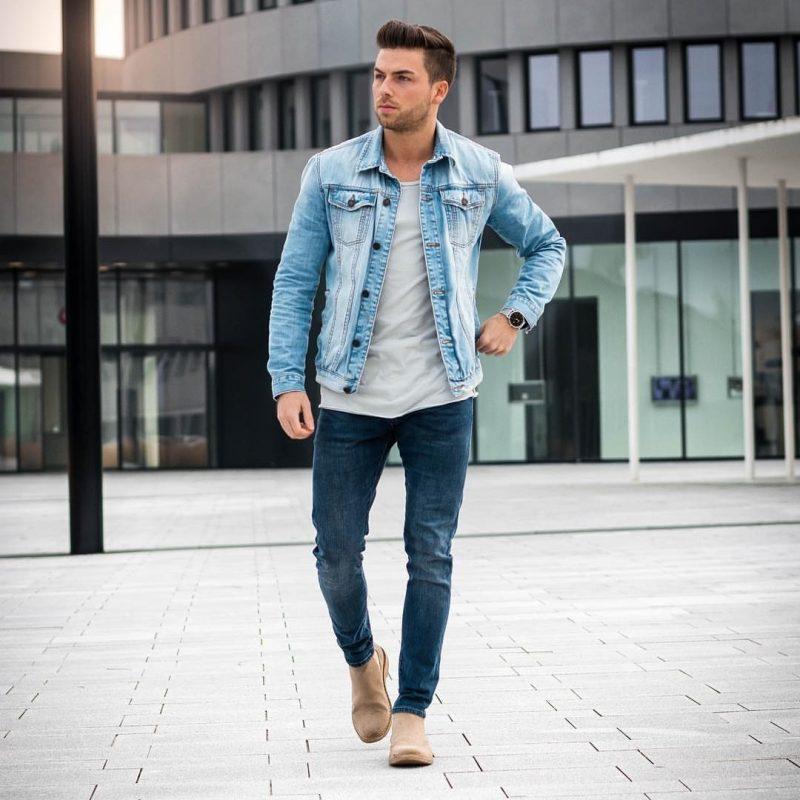 Blue denim jacket, light gray tee, blue jeans, suede boots