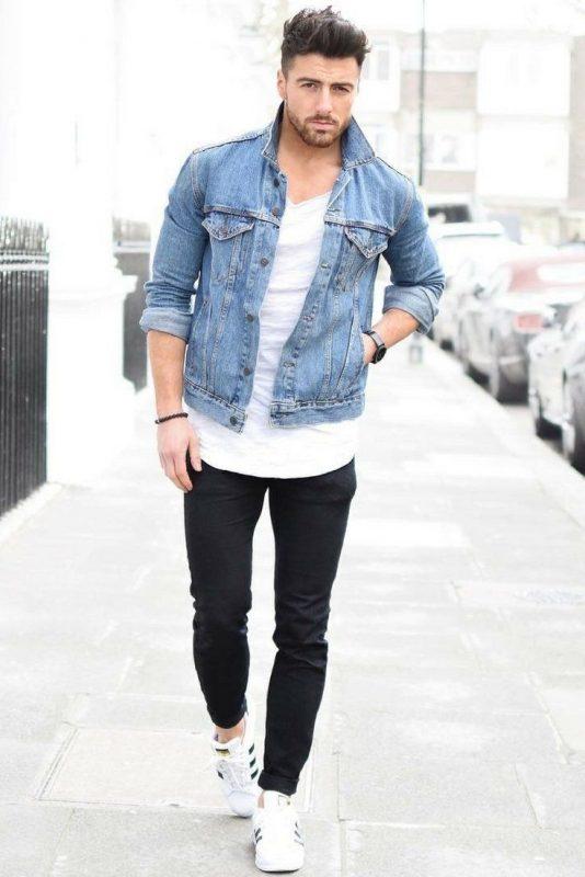 White v-neck tee, blue denim jacket, black jeans, sneaker